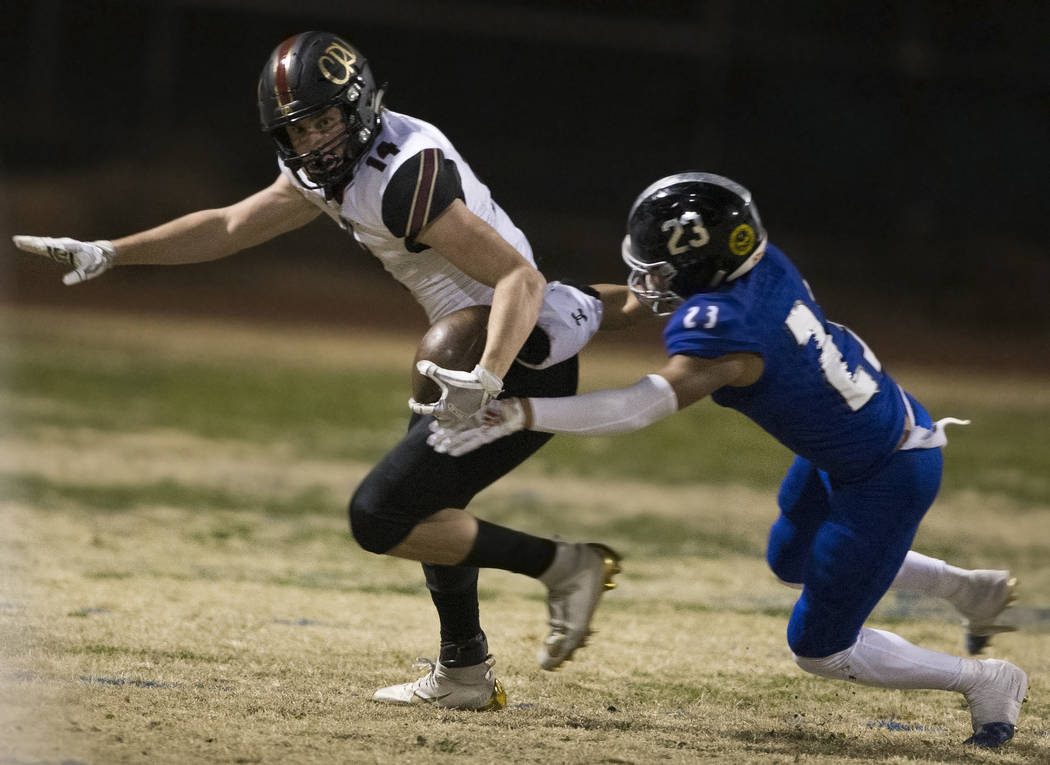 Faith Lutheran senior wide receiver Peyton Thornton (14) turns up field past Desert Pines senio ...