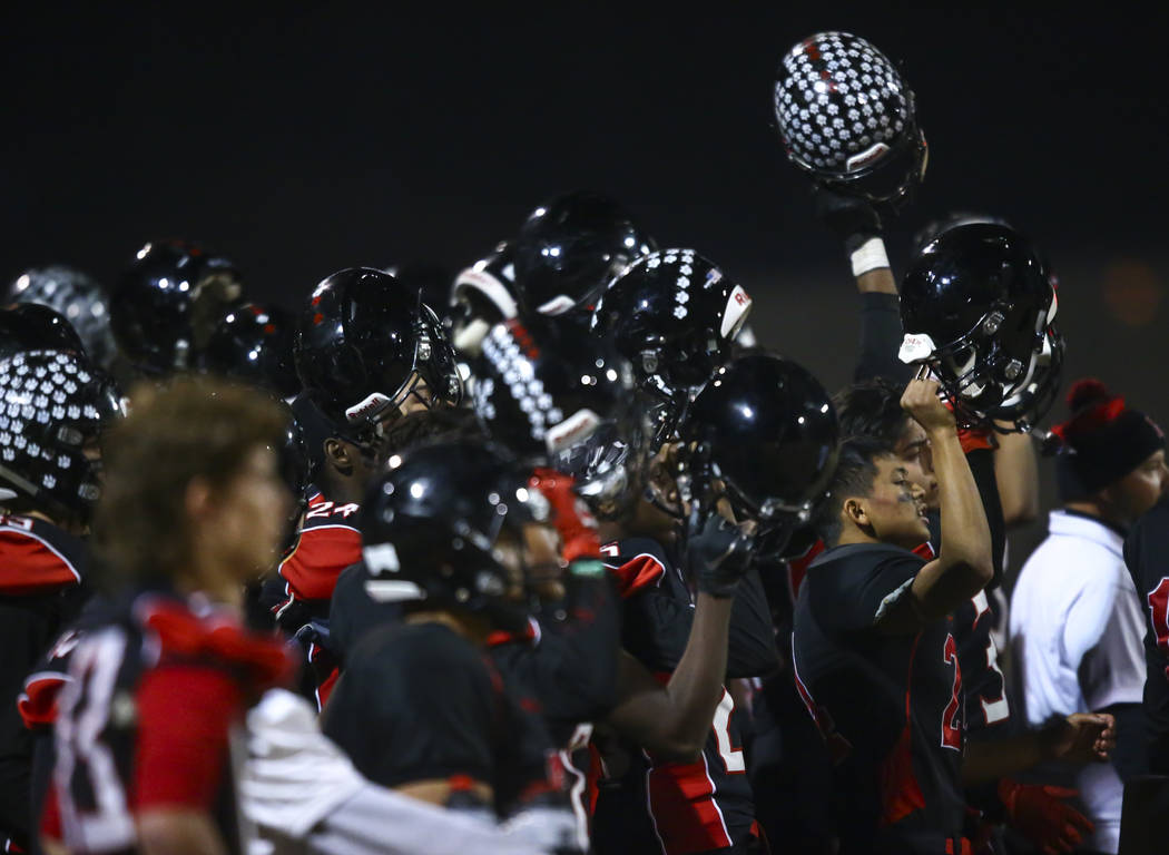 Las Vegas players cheer during the first half of a football game against Palo Verde at Las Vega ...