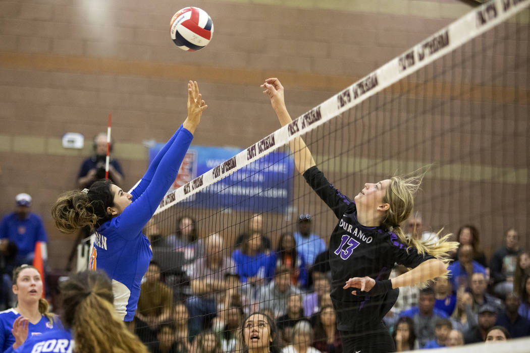 Durango High School's Bailey Olbur, right, jumps as Bishop Gorman High School's Julianne Carlat ...
