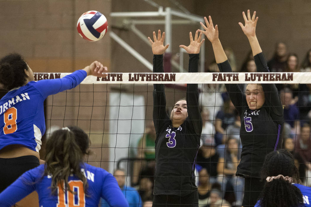 Bishop Gorman's Taylor Jefferson (8) spikes the ball against Durango's Sophia Dominguez (3) and ...