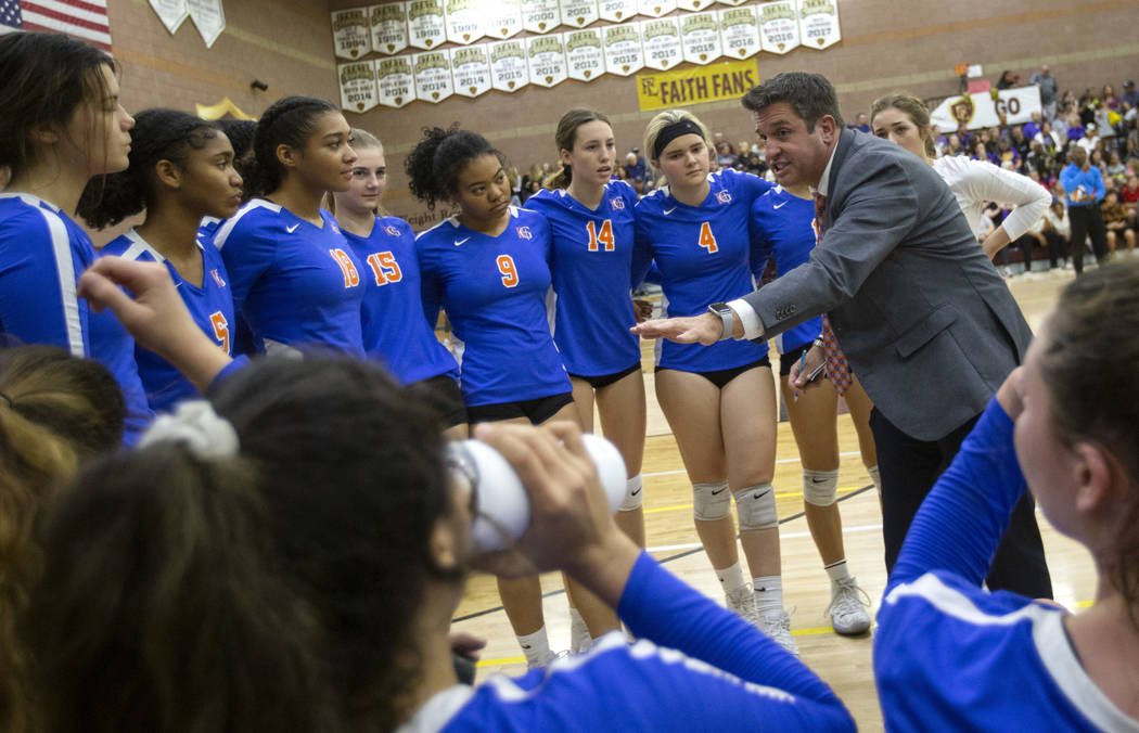 Bishop Gorman High School head coach Gregg Nunley talks to his players during a time out at the ...