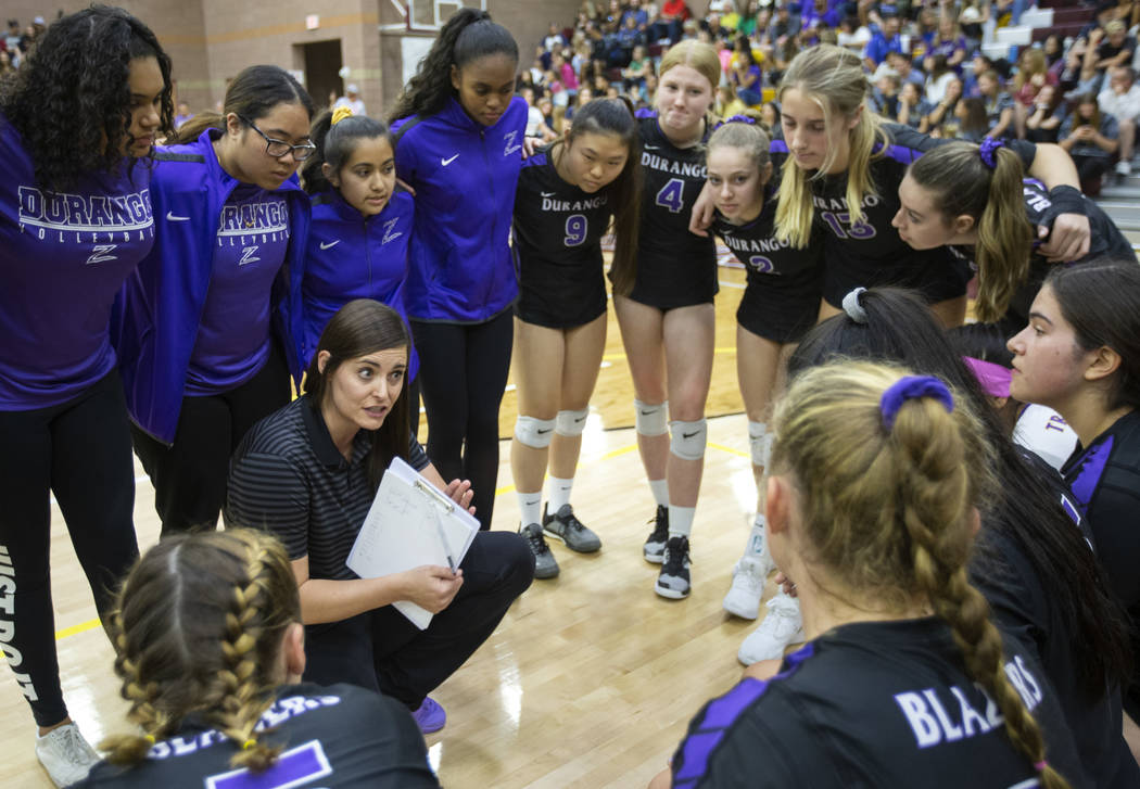 Durango High School head coach Amy Schlauder communicates with her team during a time out at he ...