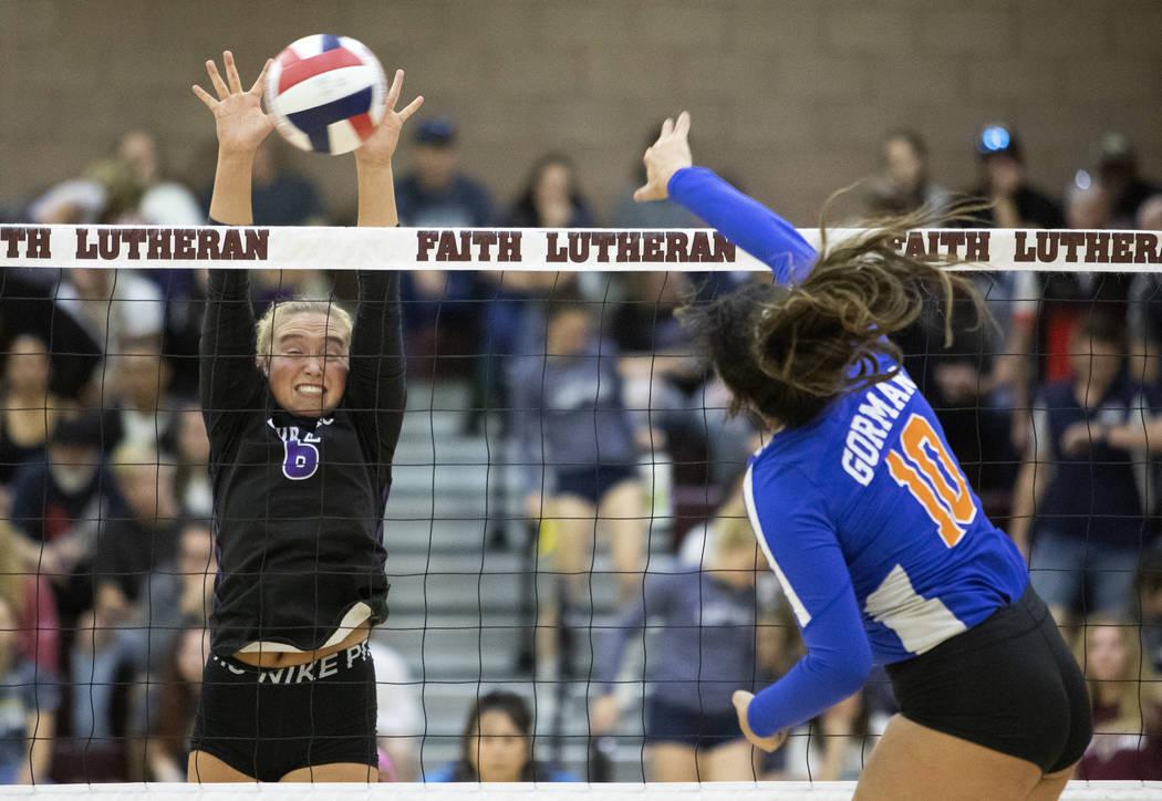 Bishop Gorman's Julianne Carlat (10) spikes the ball as Durango's Kennedi Steele (6) goes up to ...