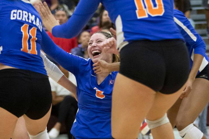 Bishop Gorman's Tommi Stockham (3) celebrates a successful kill during the match against Durang ...