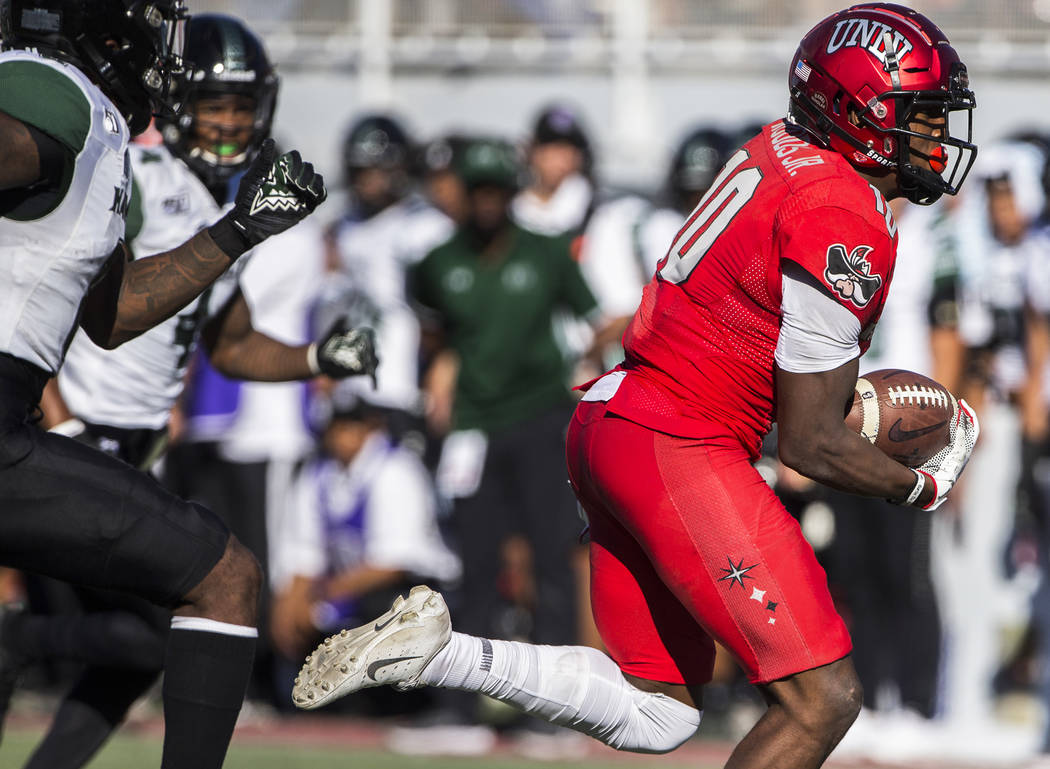UNLV Rebels wide receiver Darren Woods Jr. (10) makes a catch and run for a touchdown past Hawa ...