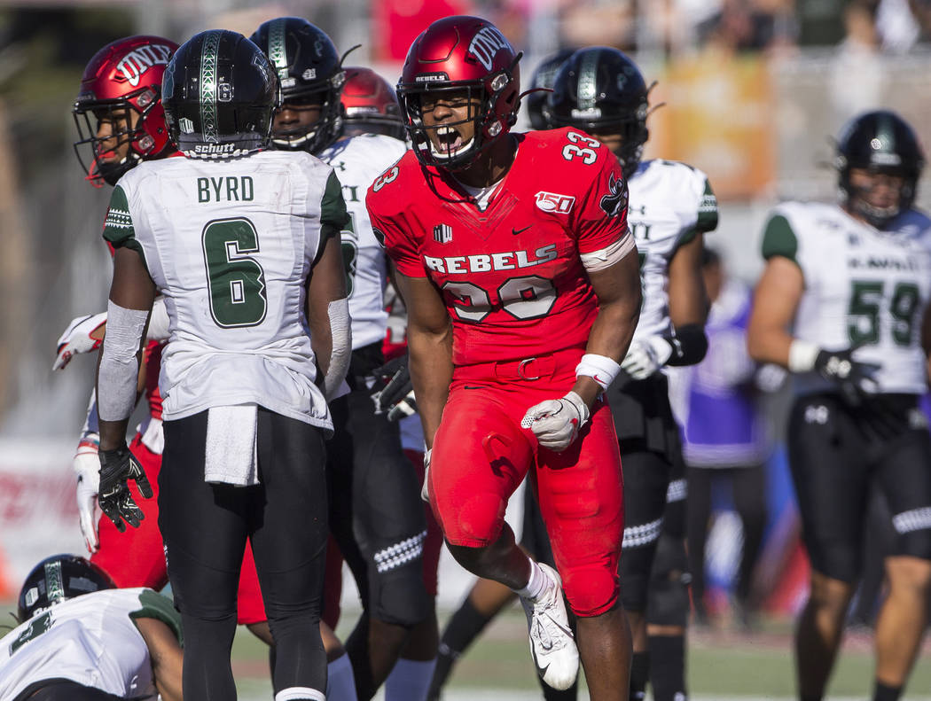 UNLV Rebels defensive back Sir Oliver Everett (33) celebrates in front of Hawaii Warriors wide ...