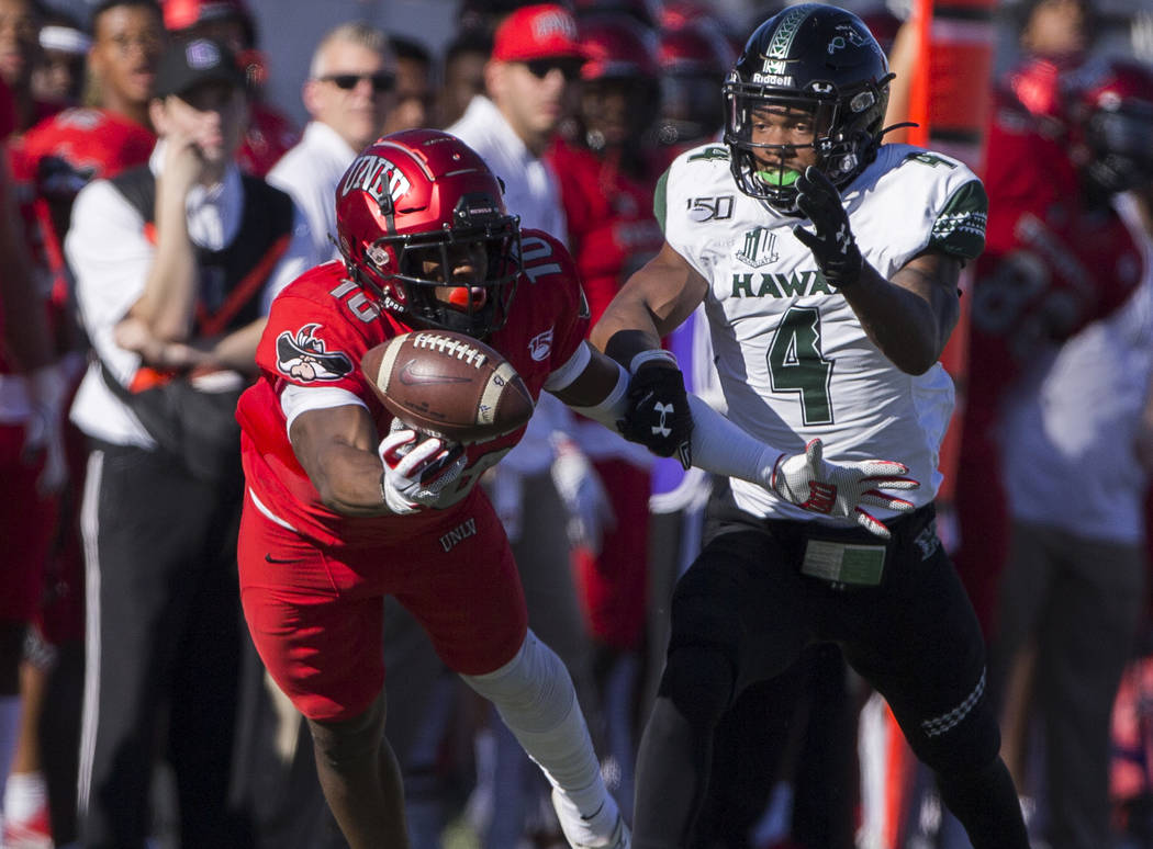 UNLV Rebels wide receiver Darren Woods Jr. (10) lays out to try and make a catch with Hawaii Wa ...