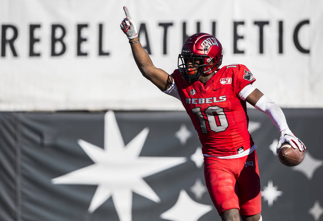 UNLV Rebels wide receiver Darren Woods Jr. (10) celebrates after scoring a touchdown in the fir ...