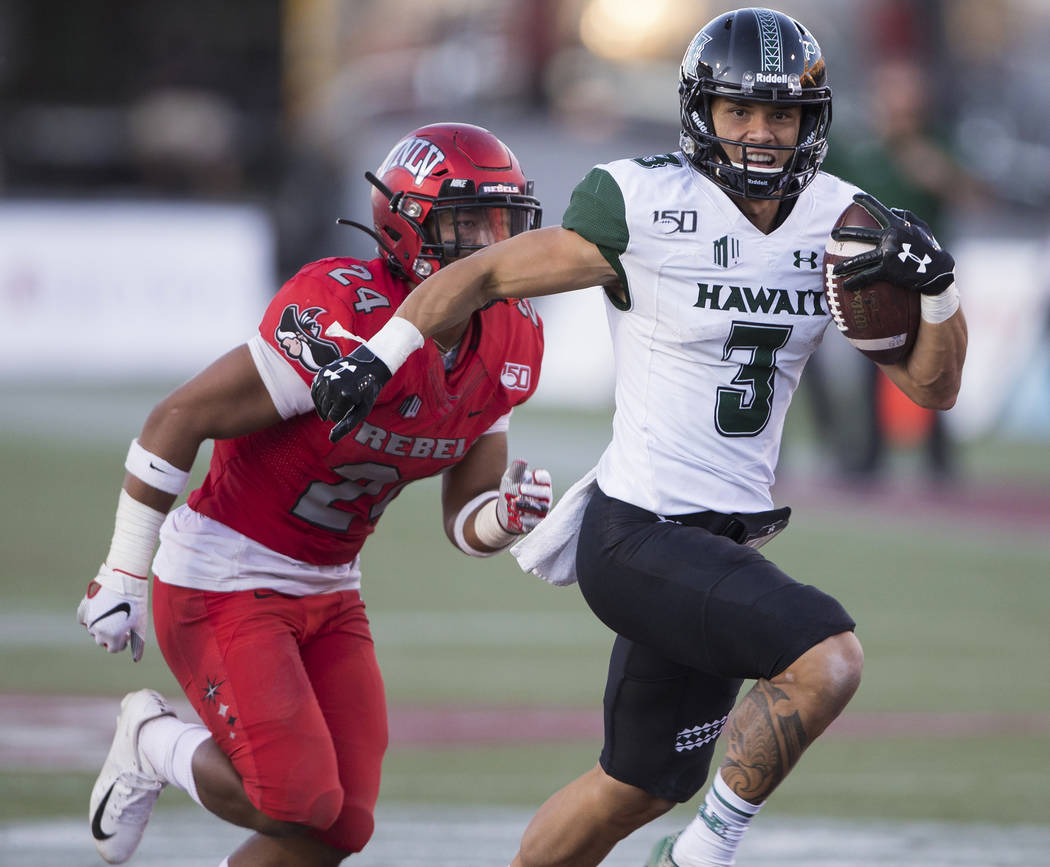 Hawaii Warriors wide receiver Jason-Matthew Sharsh (3) sprints down the sideline past UNLV Rebe ...