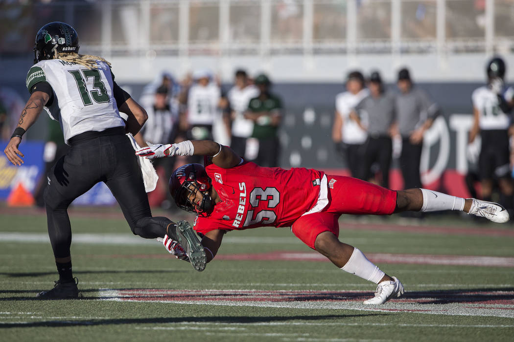 UNLV Rebels linebacker Farrell Hester II (53) dives to try and tackle Hawaii Warriors quarterba ...