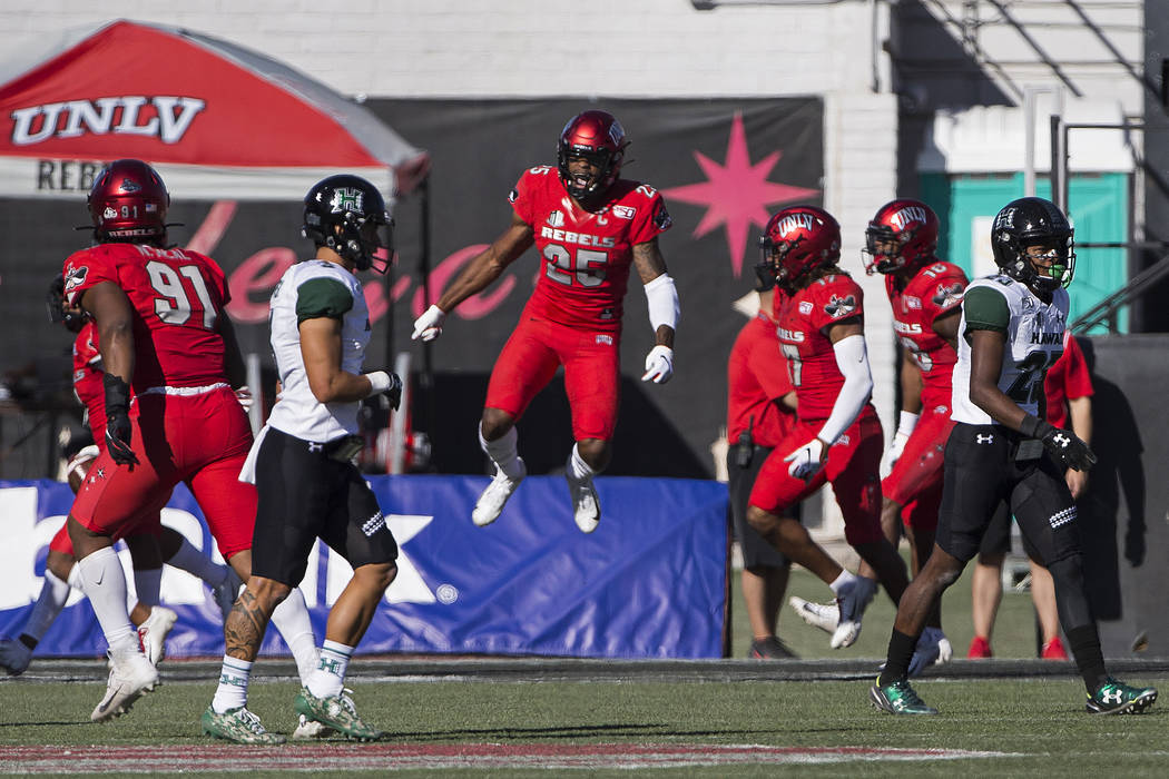 UNLV Rebels linebacker Gabe McCoy (25) celebrates a turnover in the first quarter during their ...