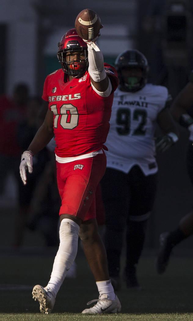 UNLV Rebels wide receiver Darren Woods Jr. (10) signals a first down in front of Hawaii Warrior ...