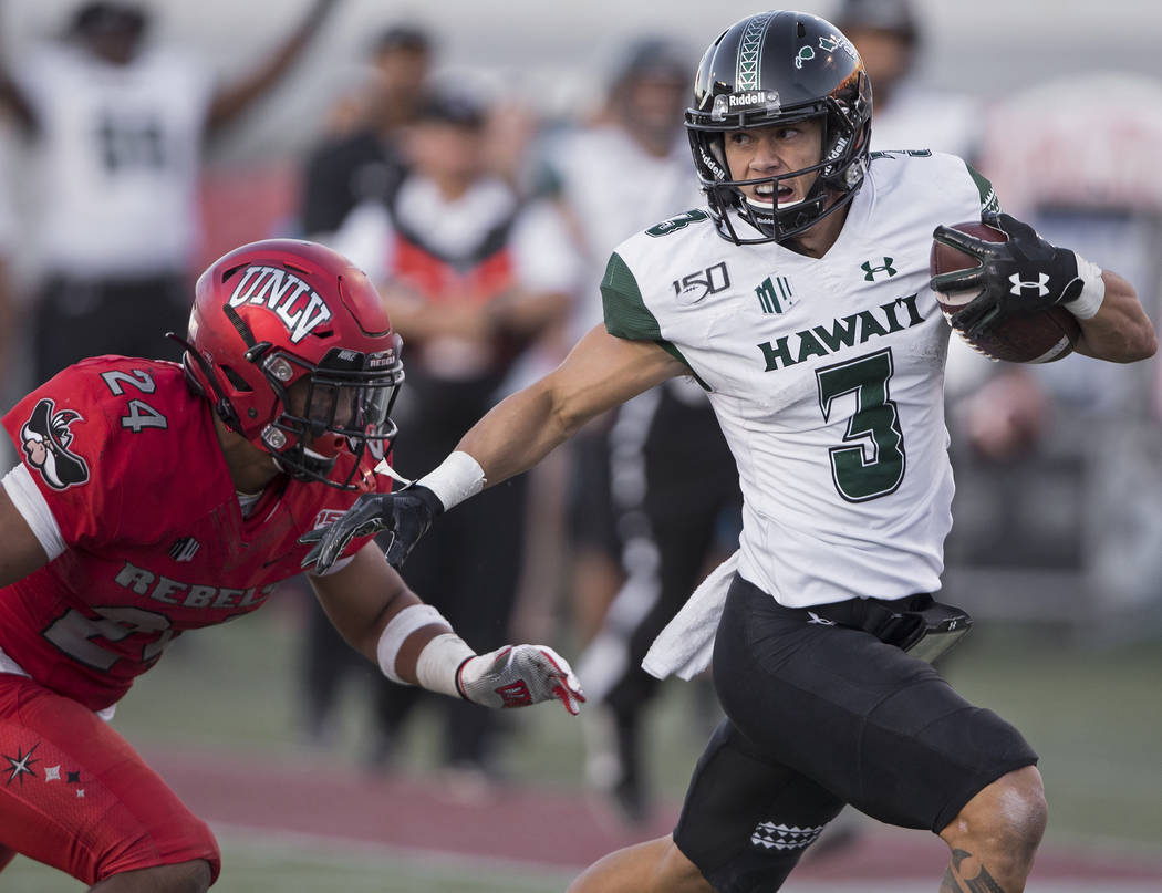 Hawaii Warriors wide receiver Jason-Matthew Sharsh (3) breaks a big run past UNLV Rebels defens ...