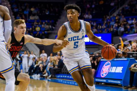 UCLA Bruins guard Chris Smith (5) drives the ball to to the outside during a college basketball ...