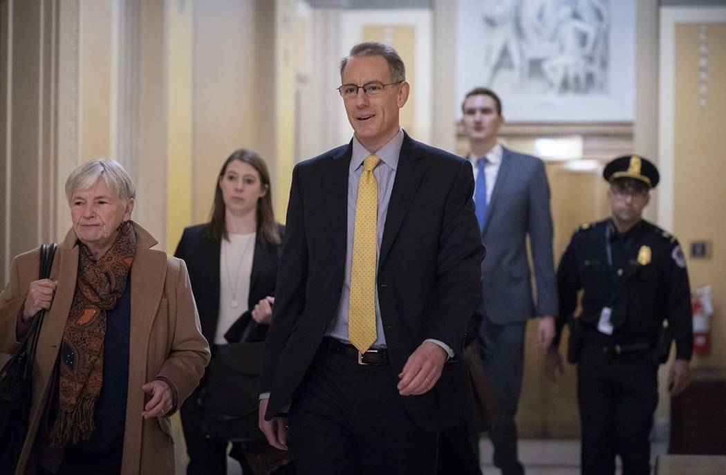 Mark Sandy, a career employee in the White House Office of Management and Budget, arrives at th ...