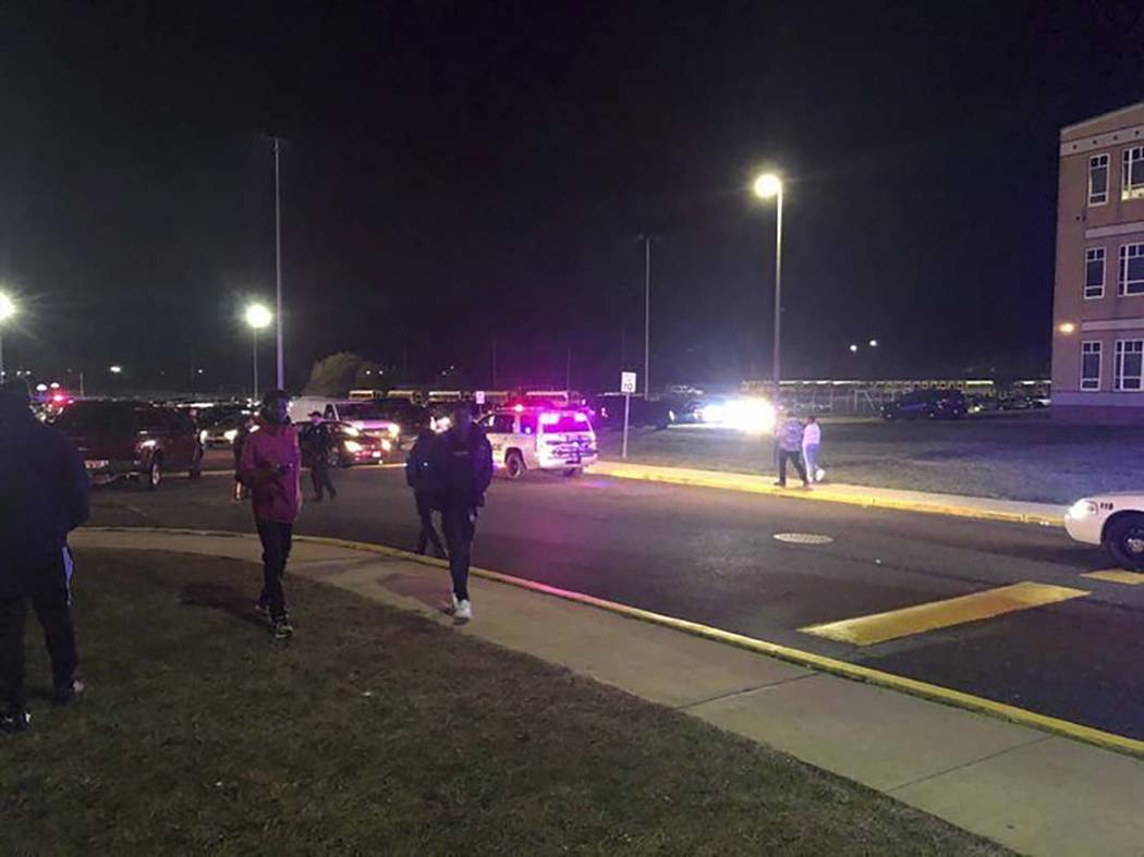 Game attendees leave after shots rang out Friday, Nov. 15, 2019, at a Pleasantville-Camden high ...