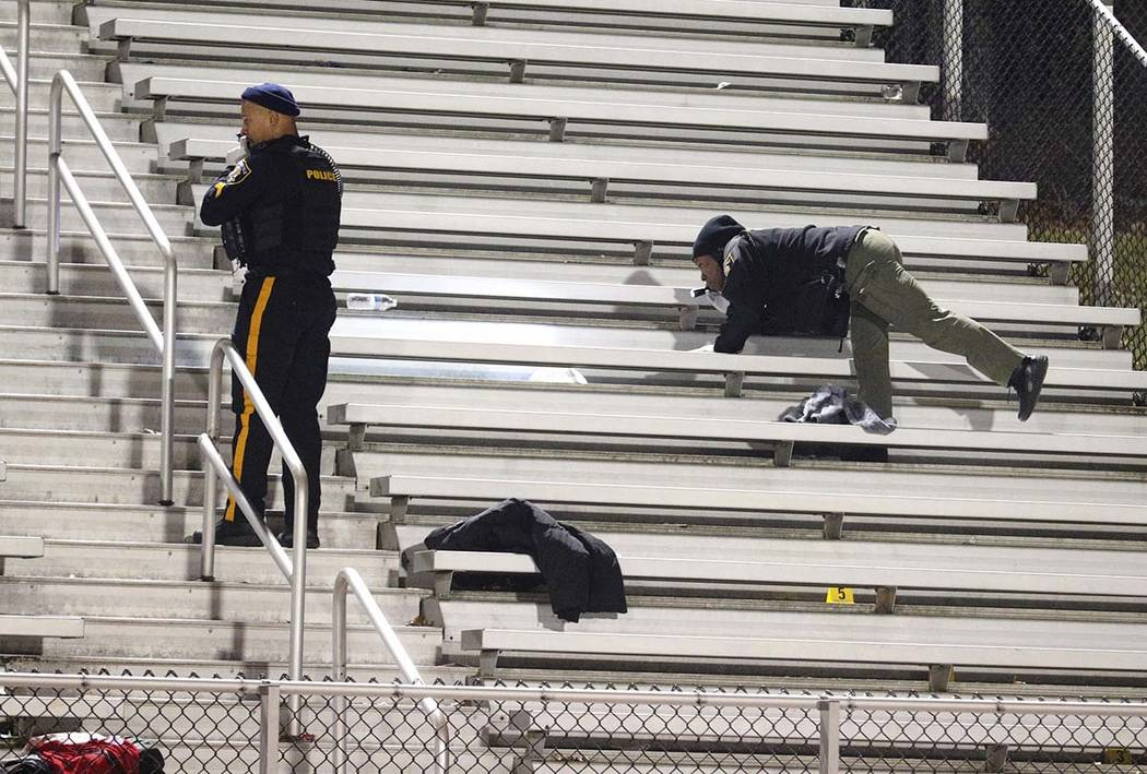 Pleasantville police search the stands after a shooting during a football game at Pleasantville ...
