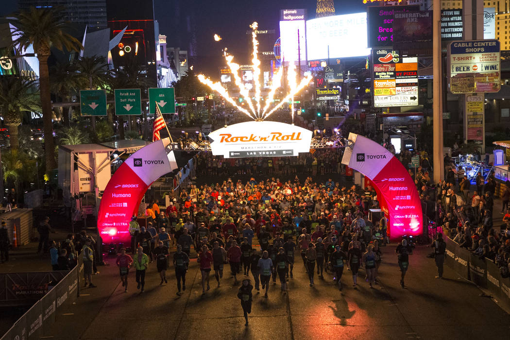 Runners leave the starting line during the 2018 Rock 'n' Roll Marathon on the Strip in Las Vega ...