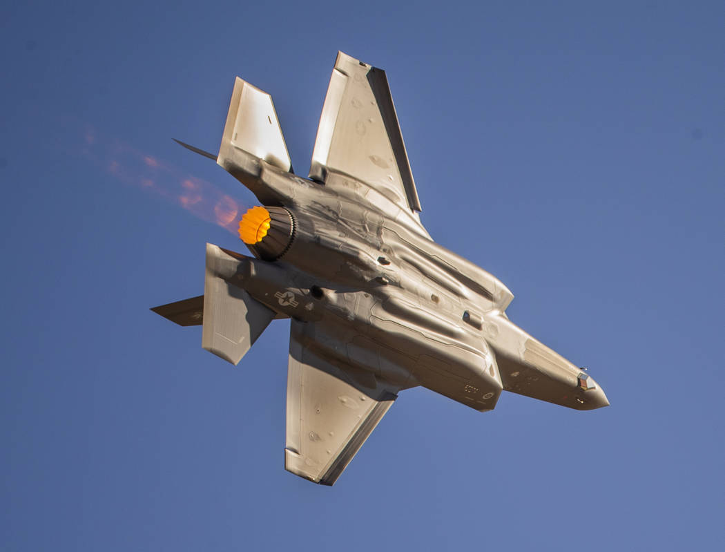 An F-35 Lightning II powers across the flight line before the crowd during the Aviation Nation ...