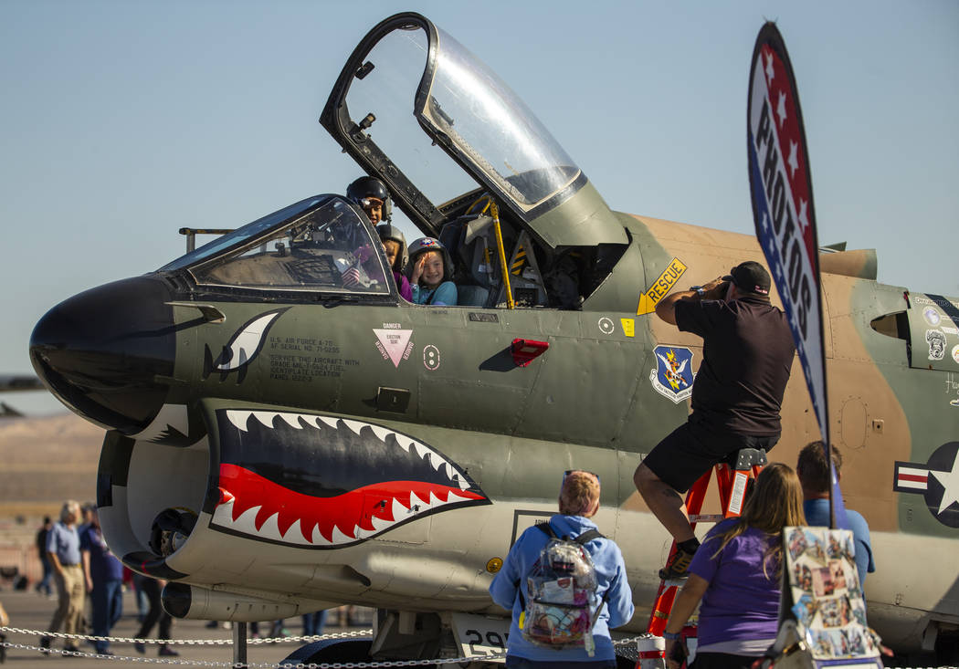 Attendees are able to have their pictures taken in an A-7D aircraft during the Aviation Nation ...