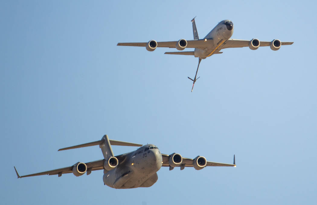 A C-17 Globemaster III, bottom left, and KC-135 Stratotanker fly together during the Aviation N ...