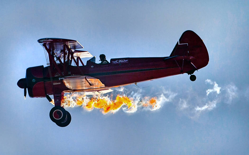 Vicky Benzing purposely stalls her 1940 Boeing Stearman to sputter out flames momentarily durin ...