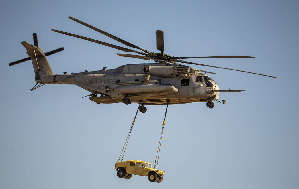 A Marine Corps CH-53 Super Stallion transports a Humvee during the Aviation Nation at Nellis Ai ...