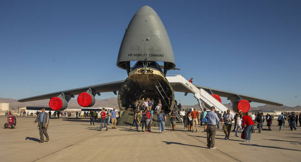 Attendees check out the Lockheed C-5 Galaxy during Aviation Nation at Nellis Air Force Base on ...