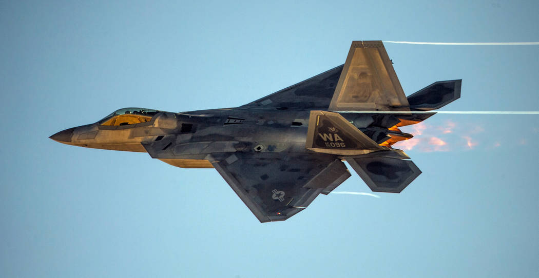 An F-22 Raptor streaks across the sky during the Aviation Nation at Nellis Air Force Base on Sa ...