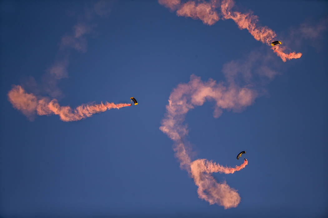 Para-Commandos with the US Special Operations Command's premier aerial parachute demonstration ...