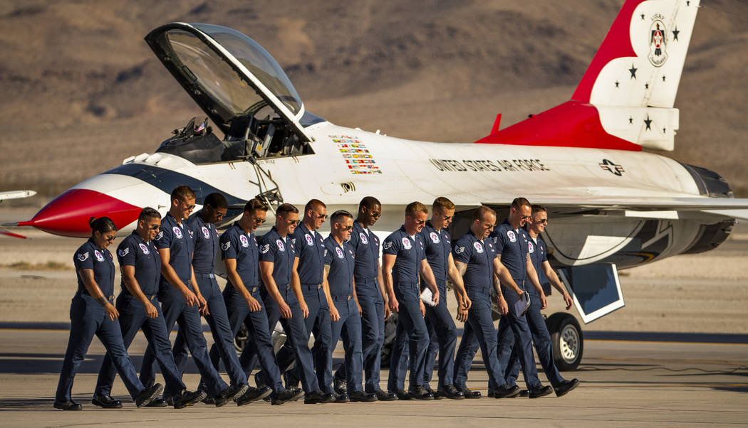 The ground crew with the U.S. Air Force Thunderbirds check for foreign objects on the tarmac be ...