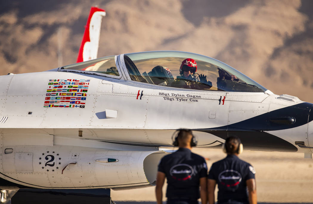 Lt. Col. John Caldwell with the U.S. Air Force Thunderbirds waves to the crowd as he taxis his ...