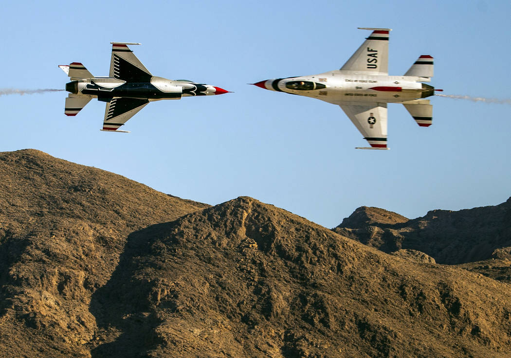 Two U.S. Air Force Thunderbirds pass within a short distance of each other during the Aviation ...