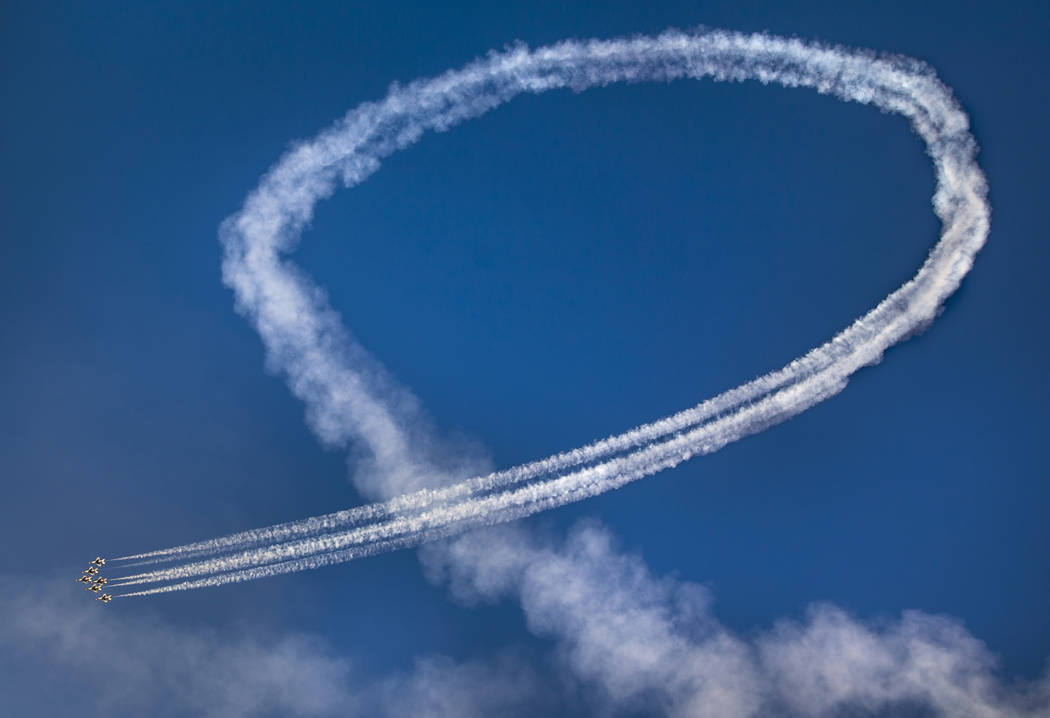 All six U.S. Air Force Thunderbirds stay in formation while completing a loop during the Aviati ...