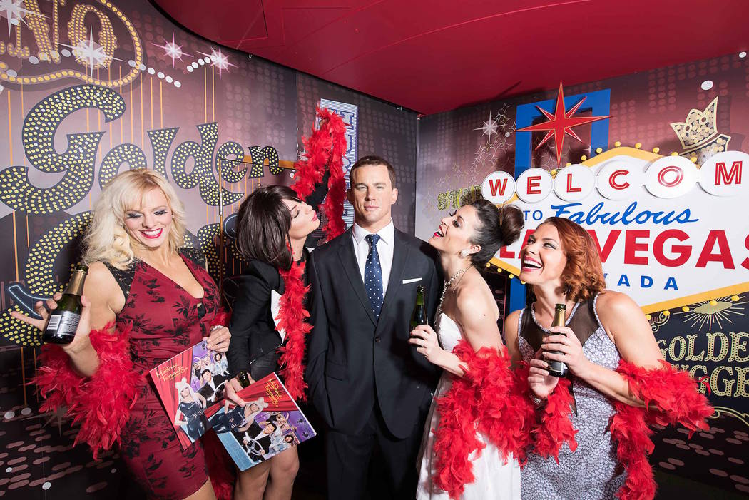 Channing Tatum's wax figure, surrounded by real-life fema is shown at Madame Tussauds at the Ve ...