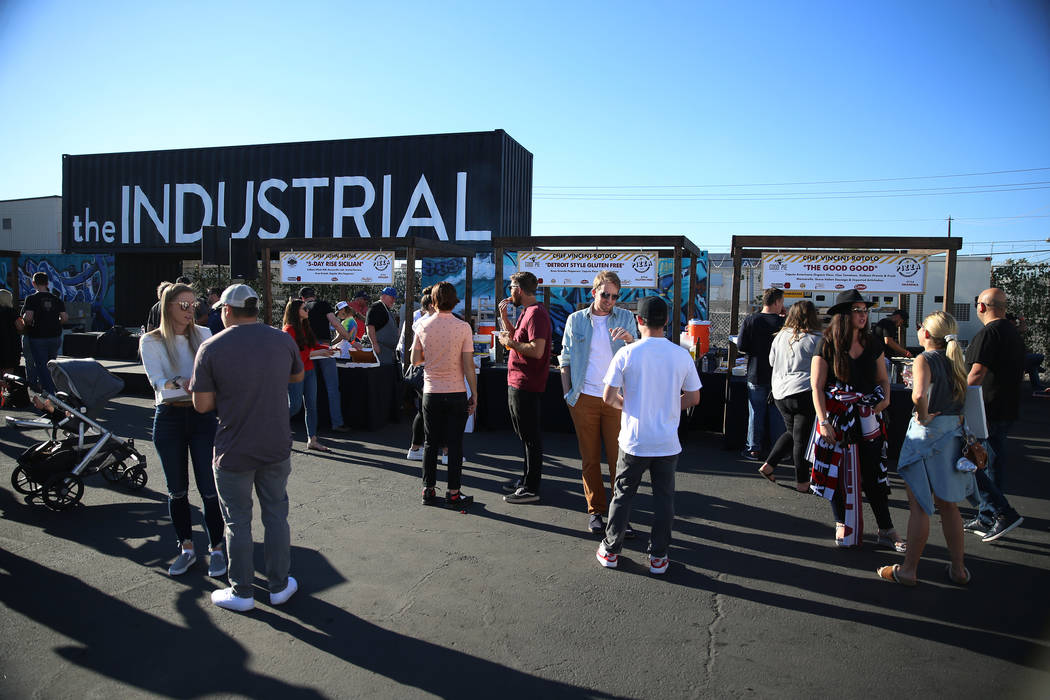People attend the Las Vegas Pizza Festival at The Industrial Event Space in Las Vegas, Saturday ...