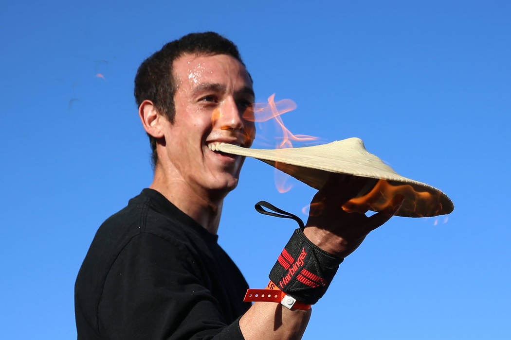 Pizza spinning acrobat Scott Volpe of Tucson, Ariz., performs during the Las Vegas Pizza Festiv ...