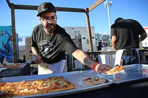 Gilbert Perez of Good Pie serves a slice of pizza during the Las Vegas Pizza Festival at The In ...