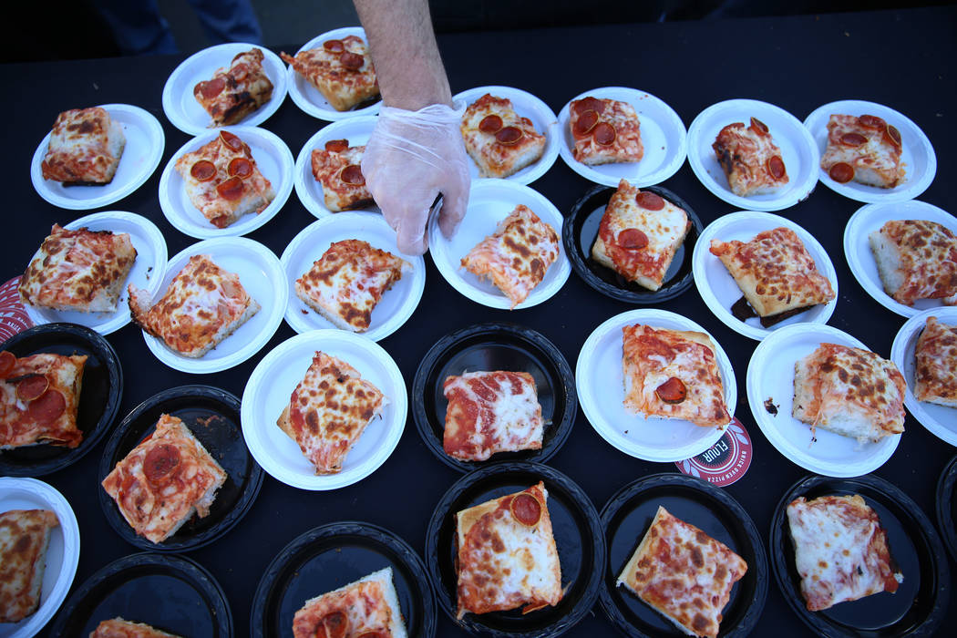 Pizza slices are served at the Flour & Barley Brick Oven Pizza booth during the Las Vegas P ...