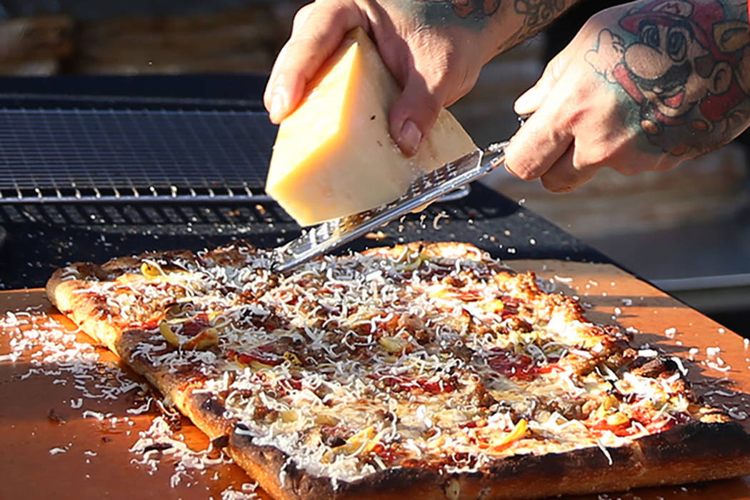 Gilbert Perez of Good Pie makes a pizza during the Las Vegas Pizza Festival at The Industrial E ...