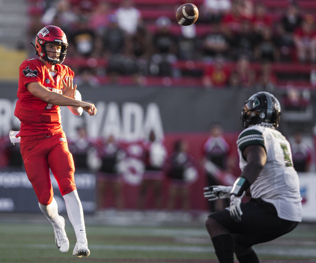 UNLV Rebels quarterback Kenyon Oblad (7) makes a throw on the run over Hawaii Warriors defensiv ...
