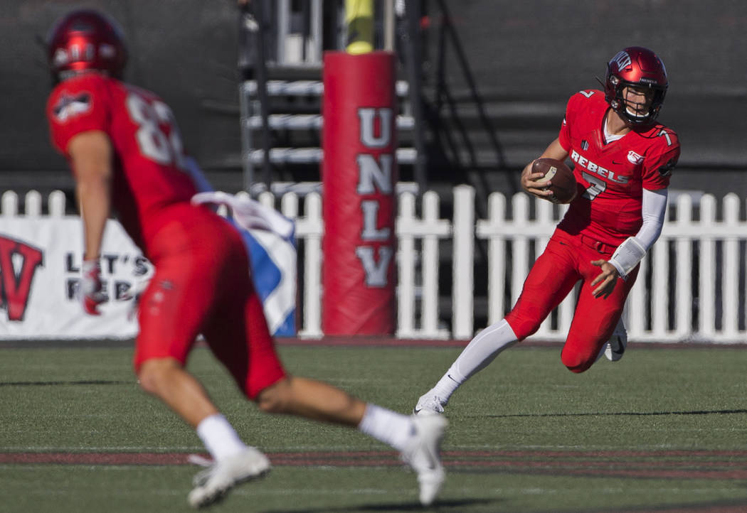 UNLV Rebels quarterback Kenyon Oblad (7) scrambles in the first quarter during their NCAA footb ...