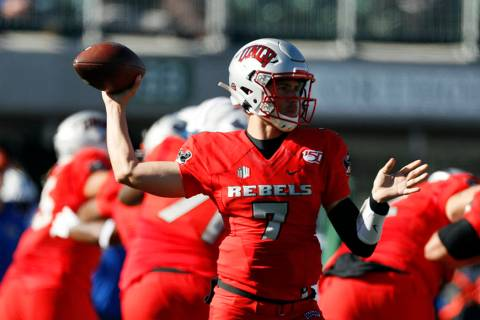 UNLV quarterback Kenyon Oblad (7) in the first half of an NCAA college football game Saturday, ...
