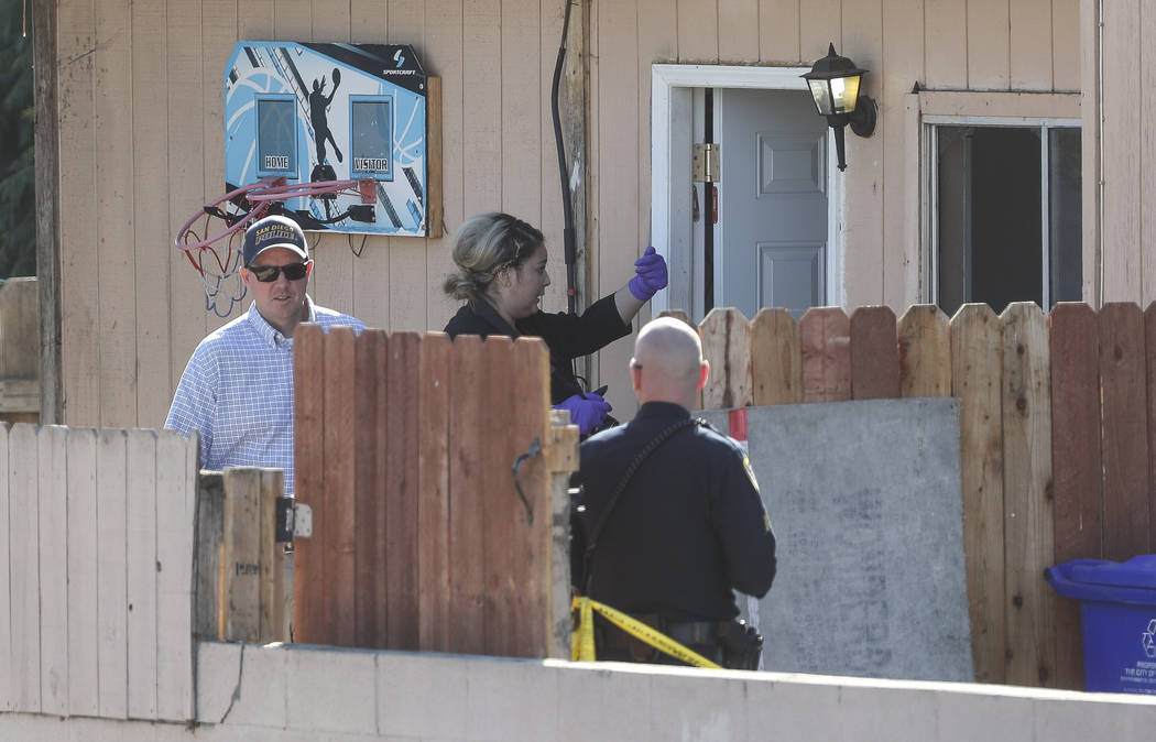 San Diego Police investigate the home where two adults and three children died from gunshot wou ...