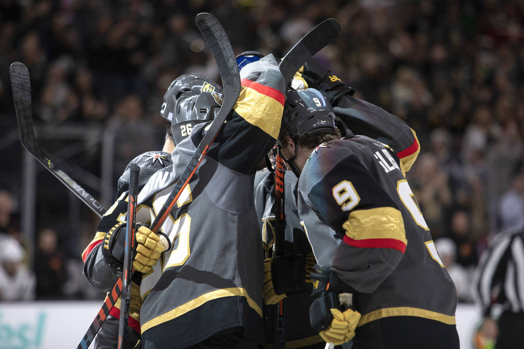 The Golden Knights' celebrate their fifth goal of the night during the third period of their ga ...