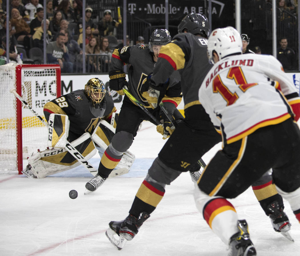 Golden Knights goaltender Marc-Andre Fleury (29) looks to block a shot against the Calgary Flam ...