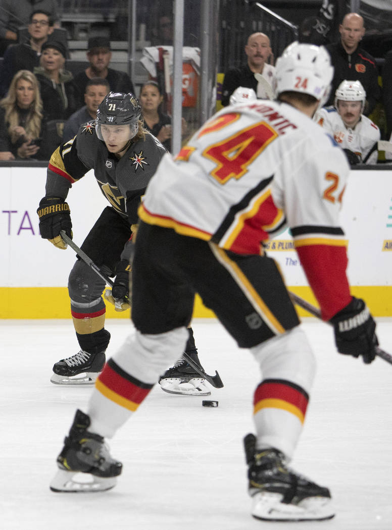 Golden Knights center William Karlsson (71) eyes the goal before scoring the first goal of the ...