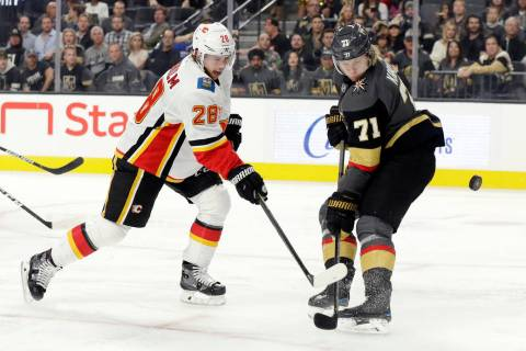 Vegas Golden Knights center William Karlsson (71) defends as Calgary Flames center Elias Lindho ...