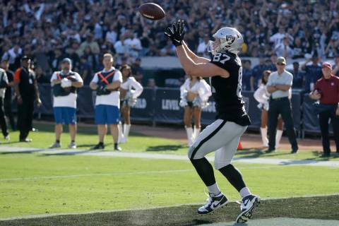 Oakland Raiders tight end Foster Moreau catches the ball for a touchdown during the first half ...