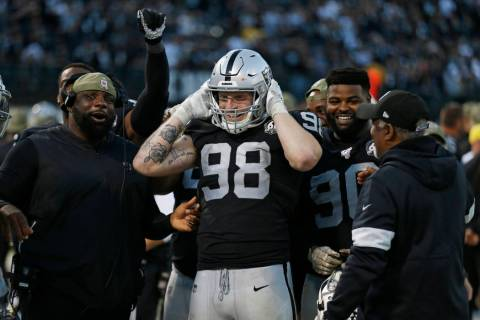 Oakland Raiders defensive end Maxx Crosby (98) on the bench during the second half of an NFL fo ...